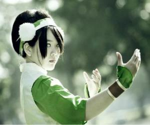 Toph Bei Fong, Toph is a girl born blind that accompanies Aang on his quest and to teach him earthbending puzzle