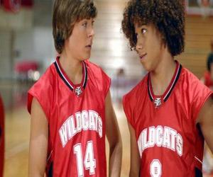 Troy Bolton (Zac Efron) and Chad (Corbin Bleu), with shirt Wildcats puzzle