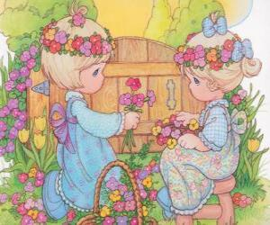 Two girls collect flowers. Precious Moments puzzle