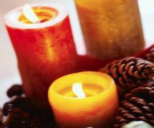 Two large Christmas candles burning puzzle