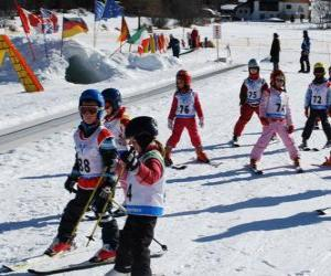 Typical winter scene with children skiing in the mountain puzzle