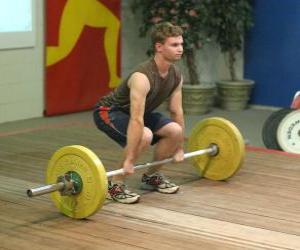 Weightlifting - Weightlifter in the beginning of the exercise puzzle