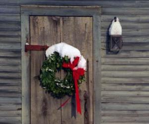 Wreath of Christmas hung in the doorway of a house puzzle