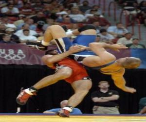Wrestling - Two wrestlers and a referee in a fight puzzle