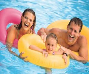 Young couple with their daughter in the pool puzzle